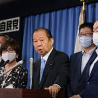 Liberal Democratic Party Secretary-General Toshihiro Nikai (center) speaks to the media at the LDP's headquarter in Tokyo on Tuesday. | AFP-JIJI