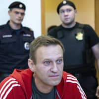 Russian opposition leader Alexei Navalny speaks to the media prior to a Moscow court session in August 2019.  | AP