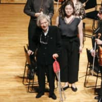 Seiji Ozawa (center) acknowledges the audience after conducting at a music festival in Matsumoto, Nagano Prefecture, in August 2019. | KYODO