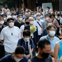 Measures such as the wearing of masks and avoiding close contact are expected to become more ubiquitous in the wake of the coronavirus pandemic. | REUTERS