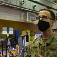 Tech. Sgt. Nathaniel Nelson, who oversees the Samurai Fitness Center at Yokota Air Base, said a space that used to be a basketball court has been repurposed to accommodate equipment from other areas. | TOMOHIRO OSAKI