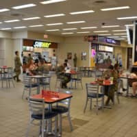 Tables in the food court area have been spaced out, with visitors required to keep masks on except when they are eating. | TOMOHIRO OSAKI