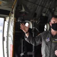Lt. Col. Steve Massie explains Monday that his aircrew are required to observe strict social distancing and mask-wearing policies regardless of temperature or weather. | TOMOHIRO OSAKI