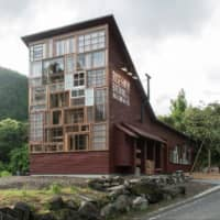 Sustainability in sight: The towering front wall of the Kamikatz brewery in Kamikatsu, Tokushima Prefecture, is made of repurposed windows. |