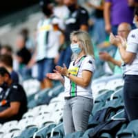 Fans cheer before a preseason friendly between Borussia Moenchengladbach and Gruether Feurth on Aug. 27 in Moenchengladbach, Germany. | REUTERS