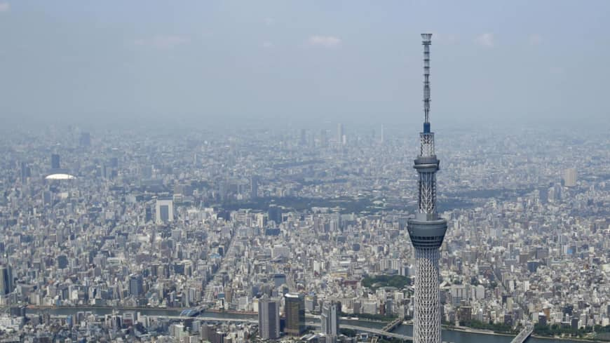 How is the novel coronavirus affecting real estate prices in Japan?