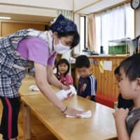 The number of children on day care waiting lists has hit a record low. | KYODO