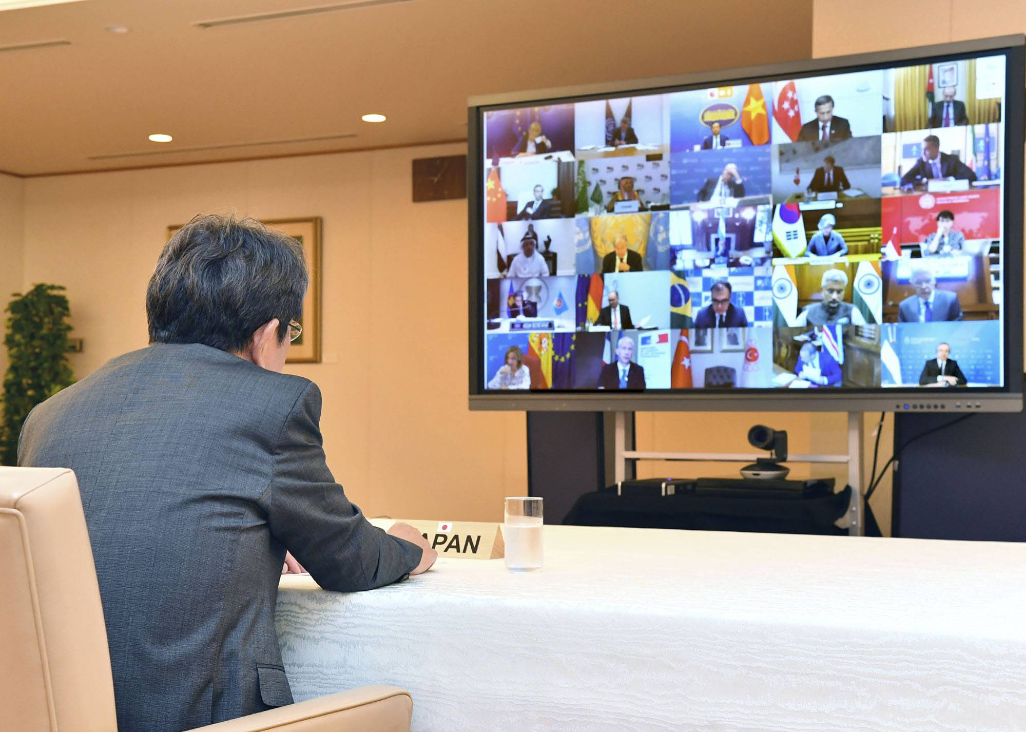 Foreign Minister Toshimitsu Motegi takes part in a teleconference of the foreign ministers of the Group of 20 major economies Friday. | FOREIGN MINISTRY / VIA KYODO