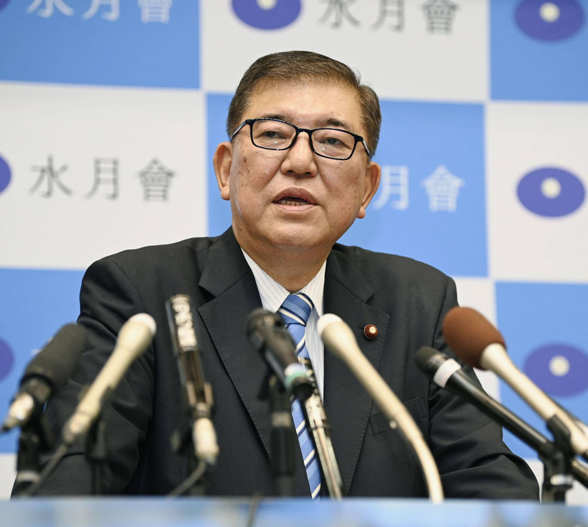 Former LDP Secretary-General Shigeru Ishiba speaks at a news conference on Friday in Tokyo. | KYODO