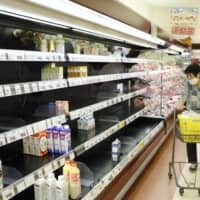 Shelves are nearly empty at a supermarket in Amami, Kagoshima Prefecture, on Friday afternoon as Typhoon Haishen approached. | KYODO