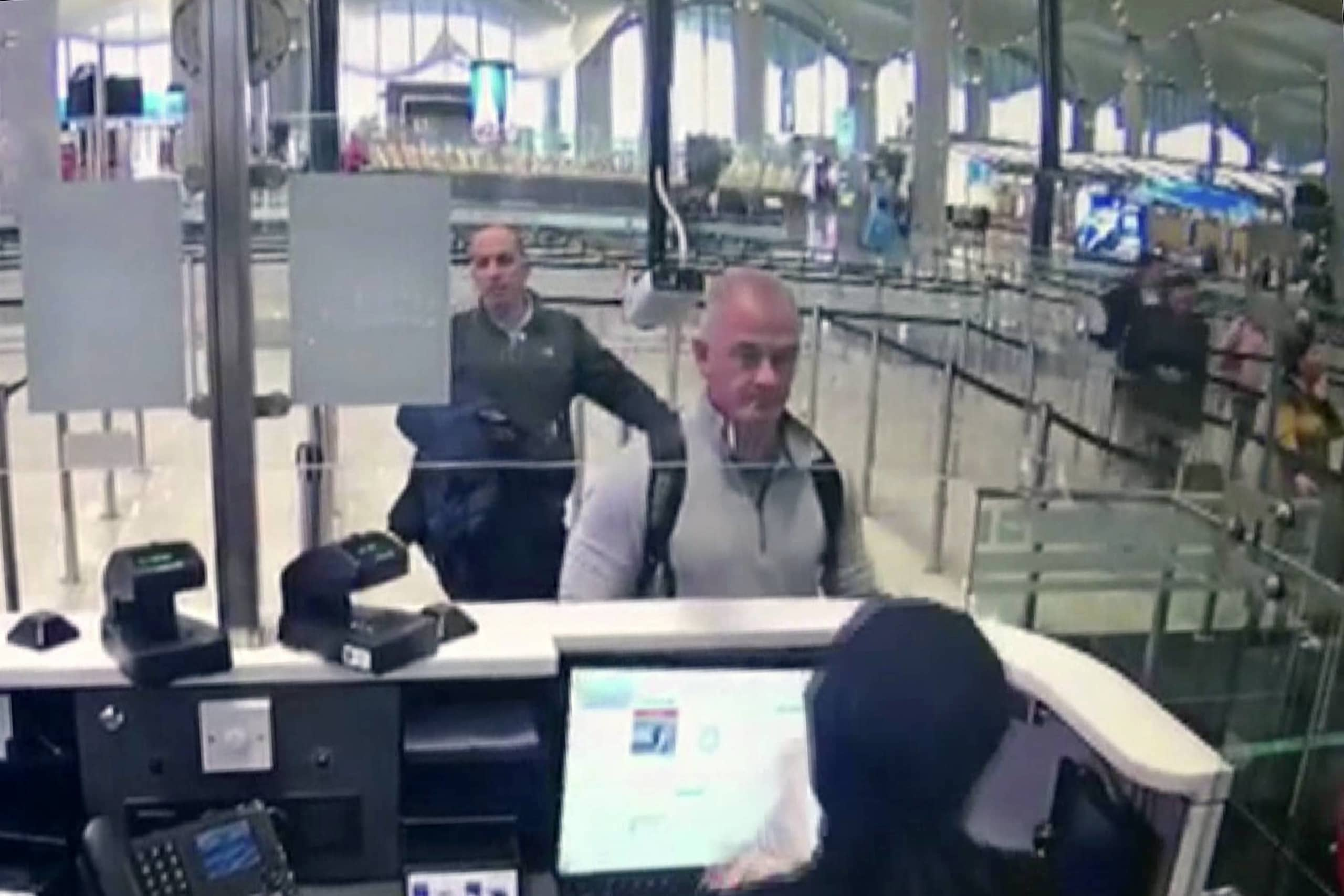 Security camera video shows Michael Taylor, center, and George-Antoine Zayek at passport control at Istanbul Airport on Dec. 30, 2019, as part of the operation to bring Carlos Ghosn to Lebanon.  | DHA / VIA AP