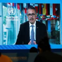 WHO Director-General Tedros Adhanom Ghebreyesus delivers a speech via video for the opening ceremony of the 2020 China International Fair for Trade in Services conference in Beijing on Friday.   REUTERS