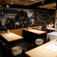 Maguro no Shimahara, a Tokyo dining bar specializing in tuna dishes, is mostly empty on Aug. 24. | REUTERS