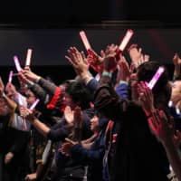 Visitors participate in a concert at Anime NYC in New York in 2019.   PAUL PETYO