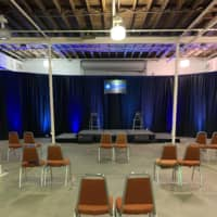 Seats are positioned in pairs around Collective Con's main room in Jacksonville, Florida in June. The room held just 200 attendees or so since visitors were separated in accordance to social distancing guidelines.   COURTESY OF TOM CROOM