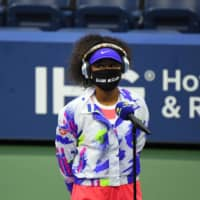 No masking the meaning: Naomi Osaka speaks to the press while wearing a face mask with the name of Elijah McClain written on it. McClain was 23 when he died after being placed in a chokehold by police in Aurora, Colorado, and administered a sedative by paramedics.  | REUTERS