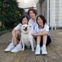 Enjoying life: Beacon and members of the Hirakata family (from left), Mao, Ayako and Shiho, enjoy going for walks together.  | COURTESY OF THE HIRAKATA FAMILY
