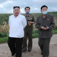 North Korean leader Kim Jong Un visits a typhoon-hit area in South Hwanghae province in this undated picture released on Aug. 28. | KCNA / KNS / VIA AFP-JIJI