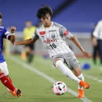 Frontale's Kaoru Mitoma (right) attacks the Marinos goal during the first half on Saturday in Yokohama. | KYODO