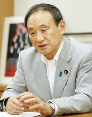 Chief Cabinet Secretary Yoshihide Suga speaks in an interview in the Diet building Saturday. | KYODO