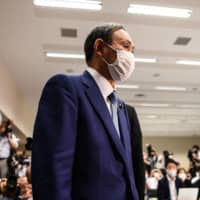 Chief Cabinet Secretary Yoshihide Suga attends a news conference to announce his candidacy for the Liberal Democratic Party leadership in Tokyo on Wednesday. | AFP-JIJI