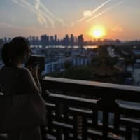 A woman visits the Yellow Crane Tower in Wuhan, China, during a media visit organized by local authorities.  | AFP-JIJI