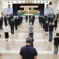 People offer prayers in Atsuma, Hokkaido, at a ceremony commemorating the second anniversary of a major earthquake that hit the region. | KYODO