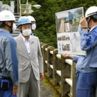 Japan to compensate for dam water release into prefectural rivers