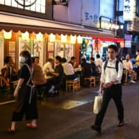 People gather at an eatery in Tokyo on Friday.  | AFP-JIJI
