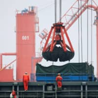 Coal is loaded into a bulk carrier at Qingdao Port, Shandong province, China, in April 2019. | REUTERS