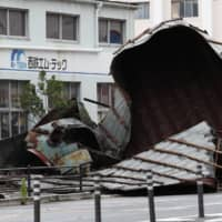 The roof of a car repair plant was blown off by high winds that accompanied Typhoon Haishen in the city of Fukuoka on Monday. | KYODO