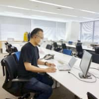 The office of Suntory Holdings Ltd. in Tokyo's Minato Ward was deserted last month as most employees were working from home. | KYODO