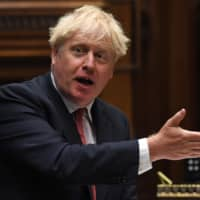 British Prime Minister Boris Johnson attends the Prime Minister's Questions in the House of Commons in London on Wednesday.  | U.K. PARLIAMENT / VIA AFP-JIJI