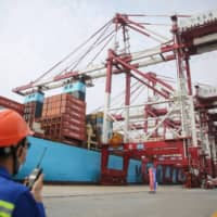 China's exports expanded more than expected in August as key markets eased virus containment measures, official data showed Monday, but imports unexpectedly shrank despite a push to boost domestic demand. | STR / VIA AFP-JIJI