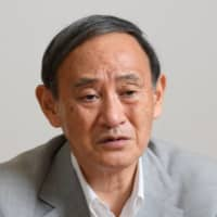 Yoshihide Suga has seldom exuded the kind of charm sometimes seen from Prime Minister Shinzo Abe, but he excelled at his job partly because he kept a tight rein on the nation's bureaucrats. | BLOOMBERG