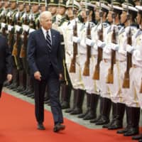 Xi Jinping, then China's vice president, attends a welcoming ceremony with then then-U.S. Vice-President Joe Biden at the Great Hall of the People in Beijing in 2011.  | BLOOMBERG
