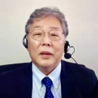Mitsuo Kaku, an infectious disease specialist, speaks during a online news conference after the15th meeting the NPB-J. League joint COVID-19 taskforce. | KAZ NAGATSUKA