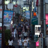 A shopping area in the Setagaya district of Tokyo. The Cabinet Office has rated the economy as 'worsening' for the 12th straight month.  | BLOOMBERG