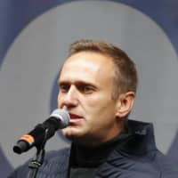Russian opposition leader Alexei Navalny speaks during a Moscow rally in September last year.   | AP