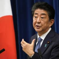 Prime Minister Shinzo Abe announces his intention to step down due to his ill health at a news conference in Tokyo on Aug. 28. | EPA / VIA BLOOMBERG