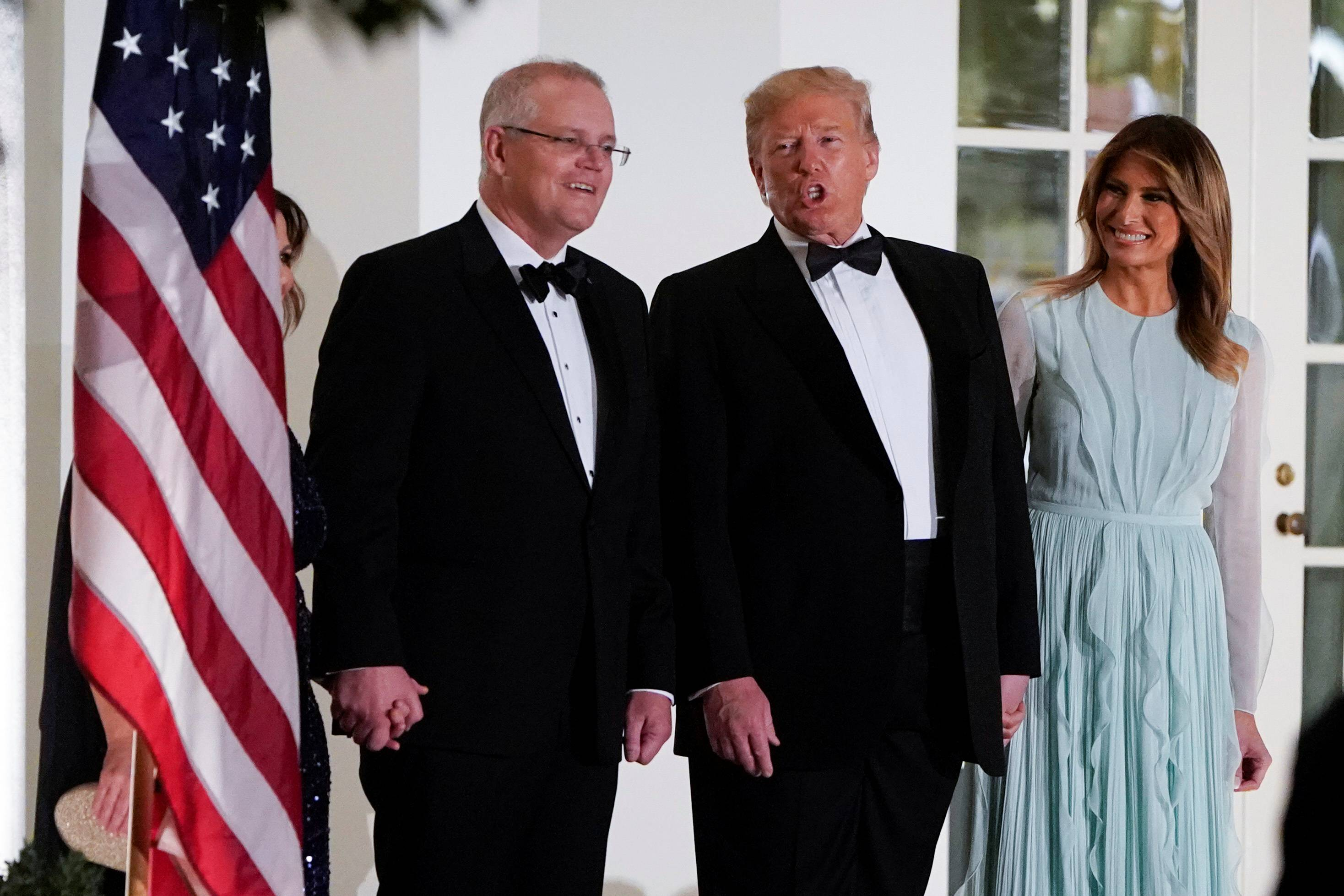 U.S. President Donald Trump and first lady Melania Trump are joined by Australian Prime Minister Scott Morrison and his wife, Jenny Morrison, for a state dinner at the White House in 2019. | REUTERS