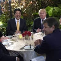 U.S. President Donald Trump sits down to dinner with Prime Minister Shinzo Abe at Mar-a-Lago in Palm Beach, Florida, in February 2017.   AP