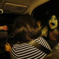 Fright night: The Kowagarasetai company is offering a drive-in haunted house attraction in Tokyo's Minato Ward.   KYODO
