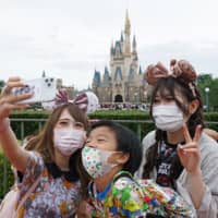 Tokyo Disney parks will charge a fee for plastic shopping bags starting Oct. 1 | AFP-JIJI / GETTY IMAGES