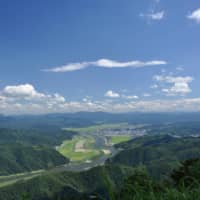 The city of Toyooka is seen in this aerial photo. | TOYOOKA CITY
