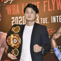 Hiroto Kyoguchi poses with the WBA light flyweight super championship belt at a news conference in Osaka on Tuesday. | KYODO