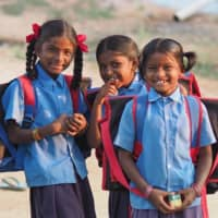 Indian girls smile in 2018 in southern India where ACE works to resolve child labor issues. | © NATSUKI YASUDA / DIALOGUE FOR PEOPLE