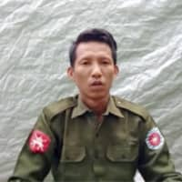 Pvt. Myo Win Tun provides a video testimony from an undisclosed location in Myanmar on July 23. Two soldiers who deserted from Myanmar's army have testified on video that they were instructed by commanding officers to 'shoot all that you see and that you hear' in villages where minority Rohingya Muslims lived, a human rights group said Tuesday.  | ARAKAN ARMY / VIA AP