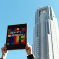 In November, protesters gather near the Tokyo Metropolitan Government Building in Shinjuku Ward to call on the capital to make a Climate Emergency Declaration. | RYUSEI TAKAHASHI