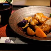 A popular meal set of cod and vegetables with black vinegar sauce is seen at a branch of fast-food dining chain Ootoya in Tokyo on Monday. Ootoya has said it takes pride in offering healthy 'mom's food' cooked on site at each restaurant, and that Colowide's method of distributing prepared meals from its central kitchens to its outlets would 'clearly lower' the quality of food.  | REUTERS